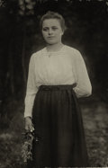 Photographs, AUGUST SANDER (German, 1876-1964). Young Woman with Flowers, 1920. Vintage gelatin silver, circa 1920. 4-3/4 x 2-1/2 inc...