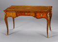 Furniture : French, A FRENCH LOUIS XV GILT BRONZE MOUNTED TULIPWOOD AND KINGWOOD BUREAU PLAT. Charles Erdman Richter (French, 1745-1829), Circa ...