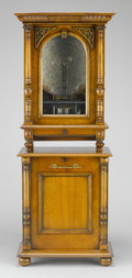 Furniture : Continental, A CARVED WALNUT COIN-OPERATED UPRIGHT POLYPHON. Late 19th Century.70 x 27-5/8 x 15-3/4 inches (177.8 x 70.2 x 40.0 cm). ...