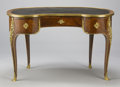 Furniture : French, A FRENCH LOUIS XV-STYLE GILT BRONZE MOUNTED MAHOGANY TABLE À ÉCRIRE. Attributed to François Linke (French, 1855-1946), Circa...