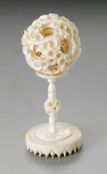 Asian:Japanese, A CHINESE IVORY OKIMONO, PUZZLE BALL ON STAND. 20th Century. Signedindistinctly . 4-1/2 inches (11.4 cm) high. ... (Total: 2 Items)