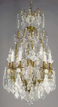 A FRENCH CUT CRYSTAL EIGHT-LIGHT CHANDELIER AND PAIR OF SCONCES Early 20th Century 42 inches (106.7 cm) high, c
