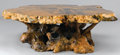 Furniture : American, A BURL WOOD COFFEE TABLE. 20th Century. 17 x 58 inches (43.2 x 147.3 cm). ...