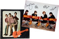 Music Memorabilia:Autographs and Signed Items, The Monkees Band-Signed Photo with Tour Book.... (Total: 2 Items)