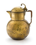 Decorative Arts, Continental:Other , Attributed to RICHARD RIEMERSCHMID FOR F & R FISCHER. AHammered Brass Water Pitcher with Raffia-Covered Handle. Stamped on...