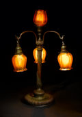 Decorative Arts, American:Lamps & Lighting, TIFFANY STUDIOS. A Four-Light Favrile Glass and Bronze Newel Post Table Lamp, circa 1910. Shades engraved: L.C.T. Favrile ...