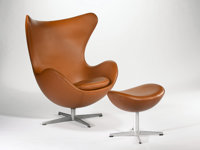 "ARNE JACOBSEN FOR FRITZ HANSEN A Leather Upholstered Aluminum ""Egg"" Chair model no. 3316 with Ottoman model no..."