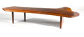 Furniture : American, GEORGE NAKASHIMA . A Slab Walnut Coffee Table, 1987. Signed anddated on base: George Nakashima Oct. 2, 1987.In...
