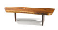 Furniture : American, GEORGE NAKASHIMA. A Slab Walnut Coffee Table. Inscribed with client's name: Frieman. 15 x 55 x 25 inches (38.1 x 139.7 x...