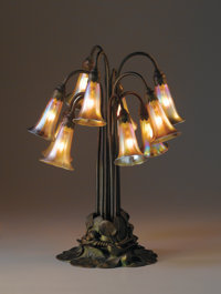 """TIFFANY STUDIOS A Ten-Light """"Lily"""" Favrile Glass and Bronze Table Lamp, circa 1910 Shades engraved: L.C.T. F..."""