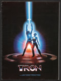 """Movie Posters:Science Fiction, Tron Lot (Buena Vista, 1982). Pressbook (Multiple Pages, 11"""" X 15"""") and Press Kit (9"""" X 12""""). Science Fiction.. ... (Total: 2 Items)"""