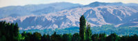 OLEG STAVROWSKY (Russian/American, b. 1927) From East Wenatchee Oil on canvas 24 x 83-1/2 inches
