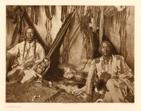 EDWARD SHERIFF CURTIS (American, 1868-1952) In a Piegan Lodge, Plate 188, 1910 from The North Ame