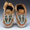 American Indian Art:Beadwork and Quillwork, A PAIR OF ARAPAHO CHILD'S BEADED HIDE MOCCASINS. c. 1875... (Total:2 Items)