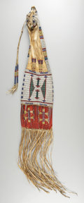 American Indian Art:Beadwork and Quillwork, A SIOUX BEADED HIDE TOBACCO BAG. c. 1880. ...