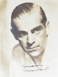 "Movie/TV Memorabilia:Autographs and Signed Items, Boris Karloff Signed Photo. A b&w 8"" x 10"" photo signed by the Frankenstein star, matted and framed to an overall size o..."