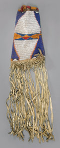 American Indian Art:Beadwork and Quillwork, A UTE BEADED HIDE TOBACCO BAG. c. 1875...