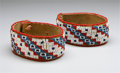 American Indian Art:Beadwork and Quillwork, A PAIR OF SIOUX BEADED HIDE ARM BANDS. c. 1920... (Total: 2 Items)