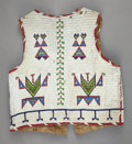 American Indian Art:Beadwork and Quillwork, A SIOUX MAN'S BEADED HIDE VEST. c. 1900...