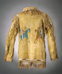A SIOUX MAN'S PICTORIAL BEADED AND FRINGED HIDE JACKET c. 1890