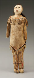 American Indian Art:Beadwork and Quillwork, A KUTCHIN BEADED AND QUILLED HIDE FEMALE DOLL. c. 1860...