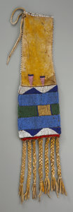 American Indian Art:Beadwork and Quillwork, A CROW BEADED HIDE TOBACCO BAG. c. 1870...