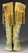 American Indian Art:Beadwork and Quillwork, A PAIR OF COMANCHE BEADED HIDE HIGHTOP MOCCASINS. c. 1880...(Total: 2 Items)