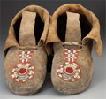 American Indian Art:Beadwork and Quillwork, AN EARLY PAIR OF INTERMONTANE QUILLED BUFFALO HIDE MOCCASINS. c.1850... (Total: 2 Items)