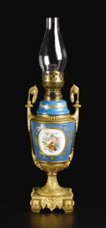 Lighting:Lamps, A French Sèvres Style Porcelain and Gilt Bronze Oil Lamp. Unknown maker, French. Nineteenth century. Porcelain with polych...