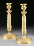 Decorative Arts, French:Lamps & Lighting, A PAIR OF FRENCH CHARLES X STYLE GILT BRONZE CANDLESTICKS. 12-1/2inches (31.8 cm) high, each. ... (Total: 2 Items)