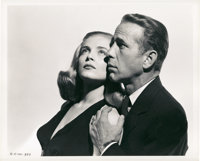 "Humphrey Bogart and Lizabeth Scott in ""Dead Reckoning"" by Robert Coburn (Columbia, 1947). Still (8"" X 10&..."