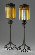 Art Glass:Tiffany , A PAIR OF AMERICAN BRONZE AND FAVRILE GLASS PRISM CANDLE LAMPS.Tiffany Studios, Circa 1910. Each base stamped: TIFFANY ST...(Total: 38 Items)