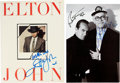 Music Memorabilia:Autographs and Signed Items, Elton John Signed Tour Book and Photo.... (Total: 2 )