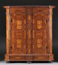 Furniture : Continental, A GERMAN BAROQUE STYLE MARQUETRY AND WALNUT ARMOIRE. Last Quarter19th Century. 82-1/4 x 73-3/4 x 27-1/2 inches (208.9 x 187...