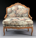 Furniture : French, A PETITE FRENCH PROVINCIAL FRUITWOOD SETTEE. 18th Century. 37-1/4 x36 x 19-1/2 inches (94.6 x 91.4 x 49.5 cm). ...