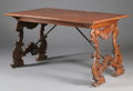 Furniture : Continental, AN ITALIAN RENAISSANCE STYLE CARVED MAHOGANY TRESTLE TABLE. 33-1/4x 61-1/4 x 37-1/8 inches (84.5 x 155.6 x 94.3 cm). ...