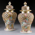 Asian:Japanese, A PAIR OF JAPANESE IMARI PORCELAIN PIERCED COVERED JARS. 19thCentury. Marked on base in red. 15 inches (38.1 cm) high, each...(Total: 2 Items)