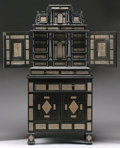 Furniture : Continental, A GERMAN PEWTER INLAID EBONIZED WOOD CABINET. 17th Century andlater. 80 x 38-5/8 x 19-1/8 inches (203.2 x 98.1 x 48.6 cm). ...