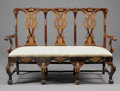 Furniture , A PORTUGUESE PARCEL GILT WOOD TRIPLE CHAIRBACK SETTEE. 19th Century. 41 x 60-1/2 x 20 inches (104.1 x 153.7 x 50.8 cm). ...