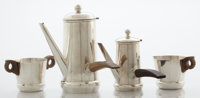 A FOUR-PIECE MEXICAN SILVER AND WOOD TEA AND COFFEE SET William Spratling, Taxco, Mexico, circa 1940 Marks: