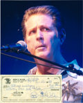 Music Memorabilia:Autographs and Signed Items, Beach Boys' Brian Wilson Signed Check.... (Total: 2 )
