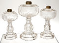 Antiques:Decorative Americana, U.S. Coin Glass: Three Graduated Coin Glass Kerosene Lamps, CentralGlass Co. of Wheeling, West Virginia, circa 1892. ... (Total: 3Items)