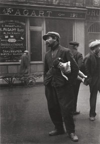 ALFRED EISENSTAEDT (American, 1898-1995) Destitute Man with Doll in Old Section of Paris, 1930 Gelat