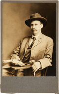 "Photography:Studio Portraits, [Charles A. Siringo] Albumen. 5"" x 8"". Texas cowboy and authorCharles Siringo is well-dressed in hat and tie as he sits in ..."