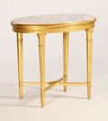Furniture : French, PAUL FOLLOT. A Gilt Wood and Marble Gueridon, circa 1925. 30 x 33 x24 inches (76.2 x 83.8 x 61.0 cm). ...