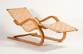 Furniture : Continental, ALVAR AALTO FOR FINMAR. A Bent Wood Chaise Longue with cross-wovenwebbing, model no. 39, circa 1930s. Marks: bearing Finmar...