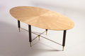 Furniture : French, BATASTIN SPADE. A Sycamore, Acajou, and Polished BronzeCenter/Dining Table, circa 1950. 29 x 74 x 39 inches (73.7 x 188.0x...