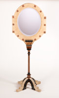 Furniture : Continental, CARLO BUGATTI. A Camelskin, Walnut, Ebonized Wood, Bone, Pewter,and Punched Copper Boudoir Mirror on Stand, circa 1900. 75 ...