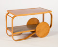 Furniture : Continental, ALVAR AALTO. A Laminated Birch/Masseur Birch Trolley with solidwood wheels, circa 1935-1936. 21-1/2 x 35 x 18 inches (54.6 ...