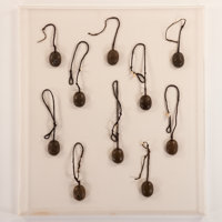 A SET OF TEN BRONZE CHARMS Gongola, Nigeria 32-1/2 x 36-1/2 inches (82.6 x 92.7 cm) frame